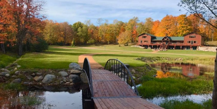 Vacation Rentals in Phelps Lodge Exterior with Bridge