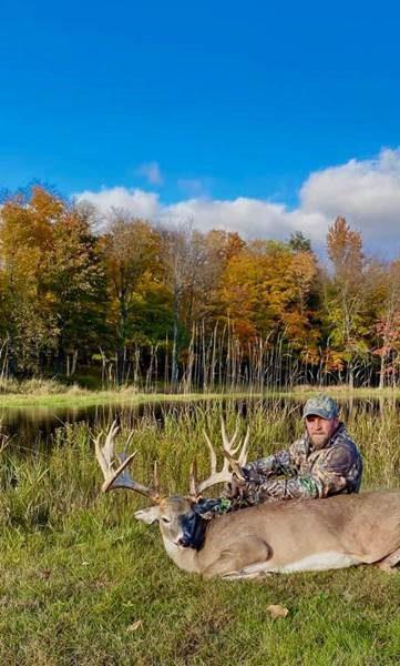 man with killed deer