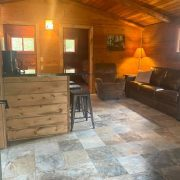 wide angle of kitchen and living room wolf cabin