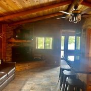 livingroom with lake view wolf cabin