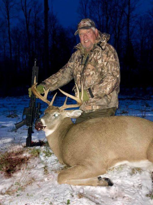 man with deer kill